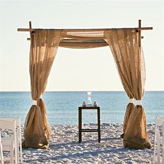 A very classic and beautiful chuppah on the beach for a perfect ceremony. beach wedding waterfront wedding gold theme