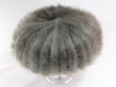 """Mink Fur Ladies Hat.  This is a vintage mink fur hat.  It has a Henry Pollack Glenover 100% wool body.  The hat is in the style of a pillbox hat.  The fur is a silvery gray color with white undertones.  It is approx. 21"""" around the inside and stands approx. 3"""" tall.  It is in excellent condition."""