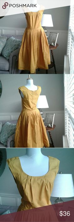 Saffron Yellow Fit & Flare Vintage eShakti Dress This vintage 1950's style saffron yellow fit & flare dress by  eShakti with simple & understated styling is so feminie and pretty.  It features a gathered scoop neckline  a gathered pleated waistline, a side zipper  and full A-line skirt. It's made from 100% cotton in a 'cheerful saffron yellow.  This has been gently worn before and is in excellent condition. eShakti Dresses Midi