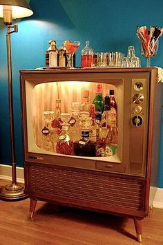 Until my kids are out of the house, id probably just keep pretty stuff in there... retro bar from an old TV