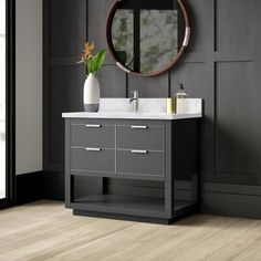 null You have to get a vanity for your bathroom, so why not make it this one? Made from solid and engineered wood, the front is adorned with metallic accents around the four drawer fronts. Only two of the drawers are fully functional, but they are soft close and will offer you some extra storage for lotions and stuff. An open shelf at the bottom gives you even more room for spare towels. Up top, the countertop and backsplash are made from stone and feature an undermount sink that is compatible w