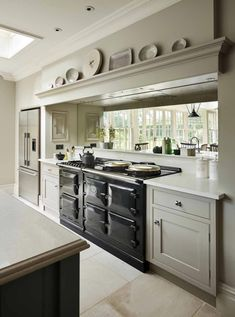A family home located in a beautiful Georgian house in the Berkshire countryside - this English Kitchen by Martin Moore combines complementary colours to add warmth and interest to the large, light kitchen. Luxury Kitchen Design, Best Kitchen Designs, Georgian Kitchen, Georgian House, Kitchen Interior, Kitchen Decor, Kitchen Ideas, Kitchen Inspiration, Interior Inspiration