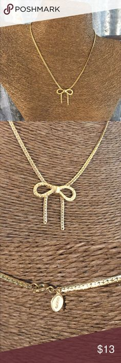 """✅sale✅Avon Gold Tone Bow Necklace Avon Gold Tone Bow Necklace in good condition. Necklace is 15"""" long & super cute. Don't pass this up. Thanks for looking.❤️❤️❤️ Avon Jewelry Necklaces"""