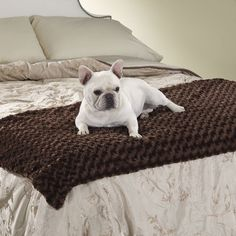 This extra plush bed scarf has a waterproof barrier so you can enjoy Fido's company without the hair and dirt!