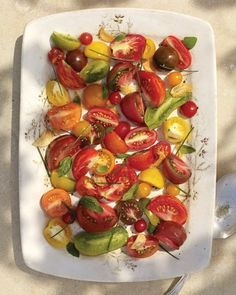 Heirloom Tomato Salad with Garlic Oil - Heat extra-virgin olive oil with thinly sliced garlic cloves to infuse it with zesty flavor. Arrange an assortment of sliced heirloom tomatoes on a platter, drizzle them with the cooled garlic oil, and sprinkle with fresh chives and basil before serving.