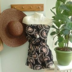 ANGIE Floral Romper! Too cute! Strapless floral print Romper with pockets. Black , tan and cream colors and has an elastic band along the top. 100% Rayon. Angie Dresses