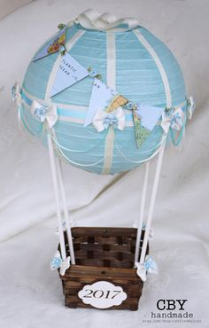 Light Blue and Ivory Hot air balloon centerpiece with Map bunting // Baby Shower Centerpiece by CraftedByYudi on Etsy Hot Air Balloon Centerpieces, Small Centerpieces, Baby Shower Centerpieces, Diy Hot Air Balloons, Baby Shower Balloons, Baby Shower Parties, Baby Boy Shower, Baby Balloon, Summer Crafts For Toddlers
