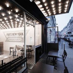 Paris... The bright lights of Broadway and the Eiffel Tower's ironwork inspired the interior of this Parisian hamburger restaurant by French studioCut Architectures