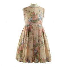 Sleeveless rose print dress in apricot with contrasting piping at the neck and armholes, fully lined and pleated from the waist, with a zip to fasten at the back.   100% Cotton  Machine Wash