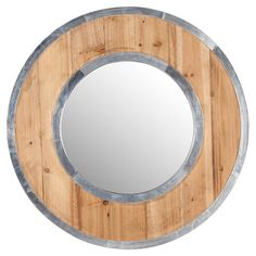 Wood wall mirror.Product:  Mirror  Construction Material:  Wood, metal, and mirrored glassColor:  Dist...