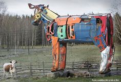 http://illusion.scene360.com/art/20669/gigantic-cows-made-from-car-parts/