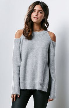"Online Only! J.O.A. delivers a stylish and cozy look this season with the Fuzzy Cold Shoulder Sweater. Crafted from an angora blend, this pullover sweater has a gray hue and cold shoulder design for just the right amount of edge. Cold shoulder design Ribbed trim Soft and fuzzy fabric Model is wearing a small Model's measurements: Height: 5'7.5'' Bust: 30"" Waist: 24"" Hips: 34'' 50% nylon, 30% angora, 20% acrylic Dry clean only Imported..."