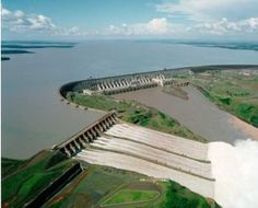 The Itaipu Dam is a hydroelectric dam on the Paraná River located on the border between Brazil and Paraguay. The name Itaipu was taken from an island that existed near the construction site. (V)
