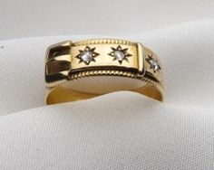 """Circa 1890. This is an elegant 15KT rose gold buckle ring. This beautiful band sparkles with three rose cut diamonds in a starburst setting. The ring is hallmarked """"Birmingham, England 1894""""."""