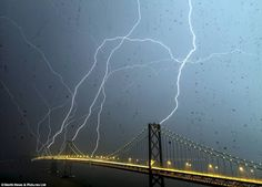 An incredible eight bolts struck the Bay Bridge in San Francisco last night which was captured in this incredible shot by photographer +Phil McGrew who took the photo through the rain-soaked window of his apartment.""
