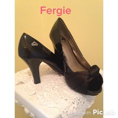 """""""Shoe Me What You've Got""""sexy shoe Fergalicious!! Definitely a crowd pleaser!! Cute satin bows over sexy peep toes!! Eye catching 3 3/4 inch heel. Body of the shoe is black patent leather!! Honey, you'll rock it in these heels!! In perfect condition!! Fergalicious by Fergie Shoes"""