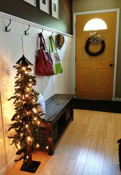 Christmas entryway -tall skinny Christmas tree for narrow hallway or small room