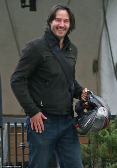 On a break: Keanu Reeves was all smiles as he stepped out for lunch with a friend in West Hollywood on Friday