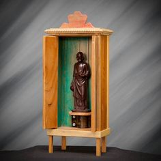 Shrine Nicho of St Joseph the Provider with a loaf of bread in one hand, a jug in the other. Wood box with turquoise green paint on the inside,
