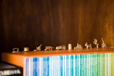 Monopoly pieces on a bookcase.