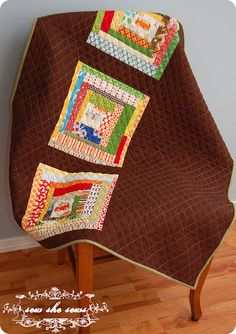 This is one clever quilter...looks like she used leftover log cabin blocks and added some additional solid fabric to create the quilt top.