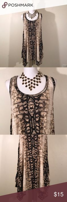 """🆕Listing/ Isabella Rodriguez Stunning Top IN EXCELLENT CONDITION NO FLAWS!  Hangs very nicely and comes to points on the sides. Snake skin design in vibrant colors. Very classy! Armpit to armpit 22""""/ shoulder to hem 36""""/ You can wear it as a dress or since Im really tall I wore it with leggings.  YOU CAN CHOOSE TO PURCHASE ONLY 1 ITEM, BUT YOU CAN ONLY PURCHASE UP TO 3 ITEMS PER ORDER. YOU MAY PURCHASE AS MANY ORDERS AS YOU WOULD LIKE. ISABELLA RODRIGUEZ Tops"""