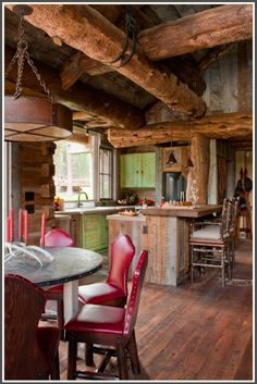 Reclaimed wood kitchen. The colours are beautiful and those natural tree trunk beams are spectacular!