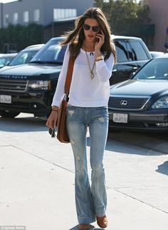 Alessandra Ambrosio.. 70's style.. flared jeans.. white..