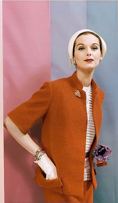 1955 Anne St. Marie in red wool jersey Jasco suit with white blouse by Anthony Blotta; cloche hat by Emme; gloves by Superb; jewelry by Cartier, photo by Erwin Blumenfeld for cover of Vogue