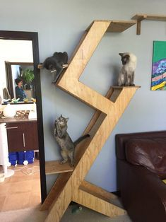 16 a minimalist plywood cat tree with several platforms and scratchers plus some cat toys hanging for a modern home - DigsDigs Cat Tower Plans, Diy Cat Tree, Cool Cat Trees, Cat Playground, Playground Design, Outdoor Playground, Cat Shelves, Cat Room, Cat Condo