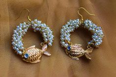 Enamoured by Fish motif , here's another unique , handcrafted goldplated fish with Crystal eye and Pearl Loreals painstakingly filled in a hoop. Statement Jewelry, Pisces, Crochet Earrings, Bead, Hoop Earrings, Pearls, Crystals, Handmade, Beads