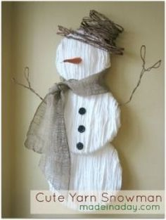 Old world snowman from polystyrene disks, wire, and wool.  Soo simple and looks wonderful!! I am going to make some of these!!