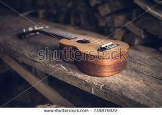 https://www.shutterstock.com/image-photo/ukulele-on-top-wood-chair-739875022?src=MDc6WB28dIsUXne3mWdJJA-1-3