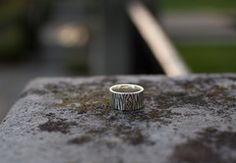Tree Bark Ring - Sterling Silver  Men's sterling silver ring with tree bark inspired texture and oxidized finishing. Adorned with the Sikra logo.