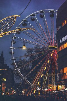 the sternschnuppen-rad (shooting star ferris wheel) at night, wiesbaden, germany