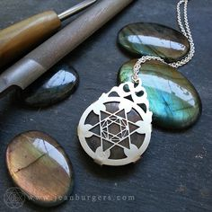 Agate and Labradorite Slab Jewellery created by Jean Burgers Jewellery. Etched labradorite collaborations, sacred geometry, flower of life and asanoha pattern.