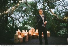 A lagoon wedding with a moody setting - fairy lights in the trees and mason jars filled with lights as beautiful decorations at this outdoor wedding   Photography by Claire Thomson