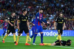 Gerard Pique of FC Barcelona argues with Diego Godin of Club Atletico de Madrid on the pitch during the La Liga match between FC Barcelona and Club Atletico de Madrid at the Camp Nou stadium on September 21, 2016 in Barcelona, Catalonia.