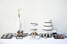 Who said a black and white dessert table would be boring?  love this!    How To Create A Wedding Dessert Table By Tempting Cake | Bridal Musings