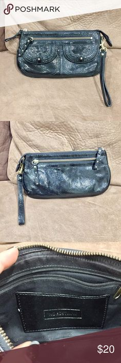 """Nordstrom patent leather wristlet Purchased at Nordstrom, carried a few times but then just in storage. Excellent used condition. Black patent leather with brass metal work. 9.5"""" bottom, 8.5"""" top, 5.25"""" tall. Nordstrom Bags Clutches & Wristlets"""