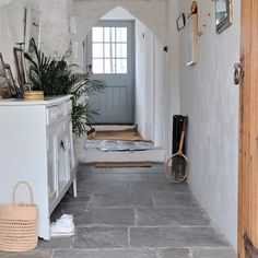 contemporary cottage style Modern country cottage House tour PHOTO GALLERY Style at Home Country Hallway, Cottage Hallway, Hallway Ideas Entrance Narrow, Modern Hallway, Entryway, Cottage Door, Cozy Cottage, Deco Champetre, Flagstone Flooring