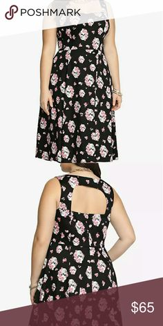 Torrid Skull Swing Dress Final Price Get the season into full swing with this edgy feminine look. A red floral pattern mixed with white skulls gives this black dress a distinct vibe. A sweetheart neckline and cutout back finish off this style with a hint of sweet sexiness.  Size 4 or 26/28w torrid Dresses