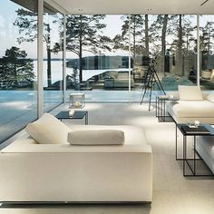 Villa Överby in Stockholm with breathtaking view that was appeared in the film The Girl with the Dragon Tattoo. This villa with Scandinavian architecture uses @minotti_spa #Hamilton sofas and #Leger coffee tables as its choices of modern decor.  Interior: Geco Architecture: John Robert Nilsson Architects Photo: Ake Lindman