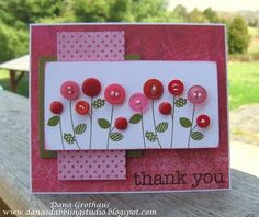 this card is not only pretty but it's also a way to use your buttons . . .
