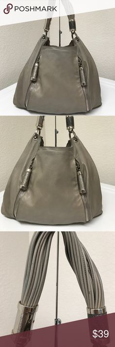Michael Kors hobo gray bag Looks pretty just has some worn sign on the edges were scuffs and fadeness in color/stain noted also on the bottom part which is not noticeable because of its location ,the opening inside has snap button that's loose but still close and open just peeling off noted around it,front has very tiny line of pen and one side has very light yellow trace but it's also not bad at all,overall this bag still gets compliments and has more life left. Michael Kors Bags Hobos