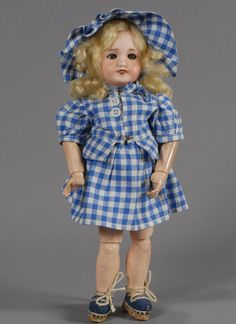 Bleuette ~ 29 cm, Unis France 301, model include a perfect bisque head (light nose rub) with very nice coloring for the era, blue glass sleep-eyes with excellent, very even, painting of her lashes and brows, and a replacement blonde mohair wig. The fully-jointed wood and composition body retains its original paint finish showing normal wear and some flaking to the hand - feet are impressed 1. GL fashion Mon Beau Village dress and original espadrilles