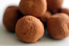 Les Truffes- 1. Melt 12 OZ SEMI-SWEET   CHOC CHIPS 2. Add 8 OZ room temp CREAM CHEESE, 3 cups POWDERED SUGAR, 2 teaspoons VANILLA 3. Refrigerate 1 hour 4. Roll into balls 5. Roll in cocoa