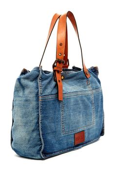 Repurpose jeans makeover into handbag with leather (possible repurpose leather belt) strap handle.