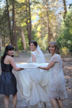 Picture of the Mom and Sister Holding the Wedding Dress love this KK and mom!