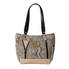 Tune into your wild side with Jungle Chic. The Leslie for Demi Miche bags is sexy and sophisticated—the perfect balance of elegance and edginess. Tan and black textured snakeskin coated canvas is offset by light tan details along the bottom. Two front zipper accents complete this exotic look. Antique brass hardware and side pockets. Rectangle-bottom design. *Miche Canada* #miche #michecanada #michefashion #fashion #style #purses #handbags #accessories